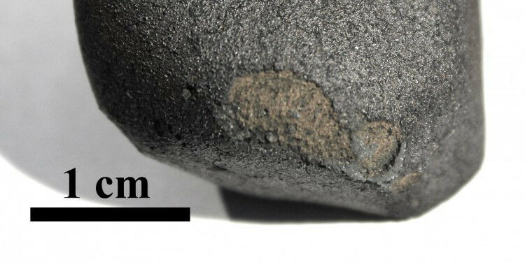 Flensburg meteorite with black fusion crust: Parts of the fusion crust were lost