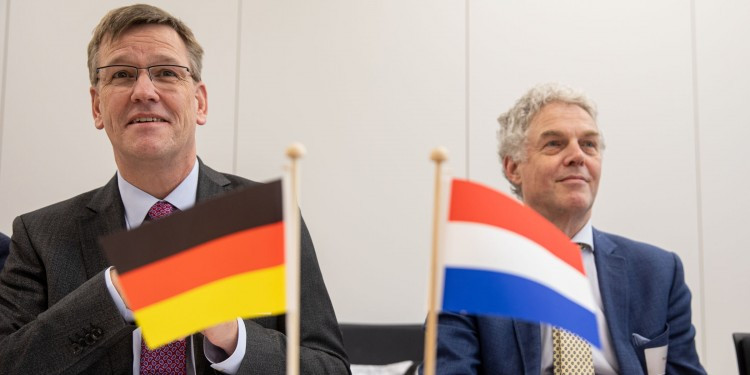 Münster University's Rector Johannes Wessels (left) and his Dutch colleague